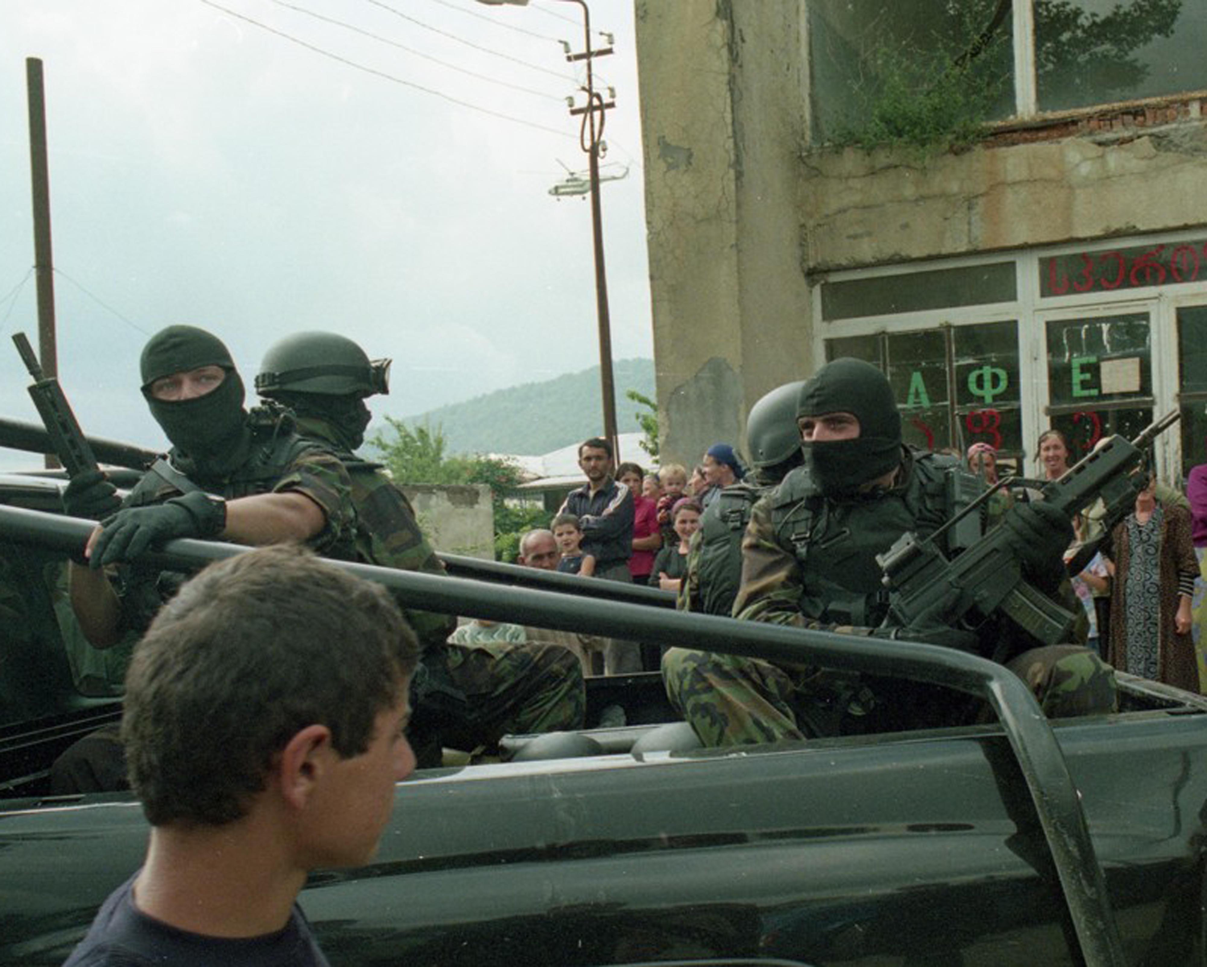 HK in Georgia-counter-terror-unit-deploying-village-duis-pankisi-gorge-2002.jpg