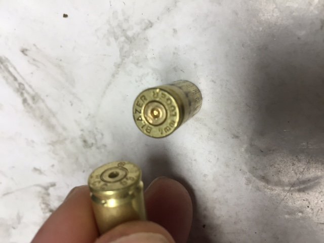 Anything other than perhaps too hot a load cause this shell case pattern- 9mm MP5 ?-img_1291.jpg